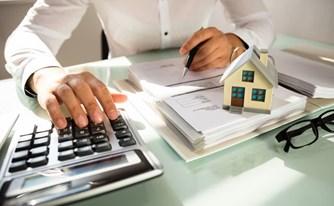כיצד ניתן להפחית את תשלום מס השבח בעת מכירת דירה או מבנה עסקי?